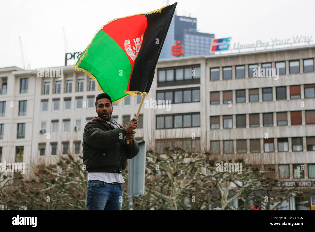 Frankfurt, Germany. 17th February 2018. A protester waves a flag of the Kingdom of Afghanistan. Afghans and German Stock Photo