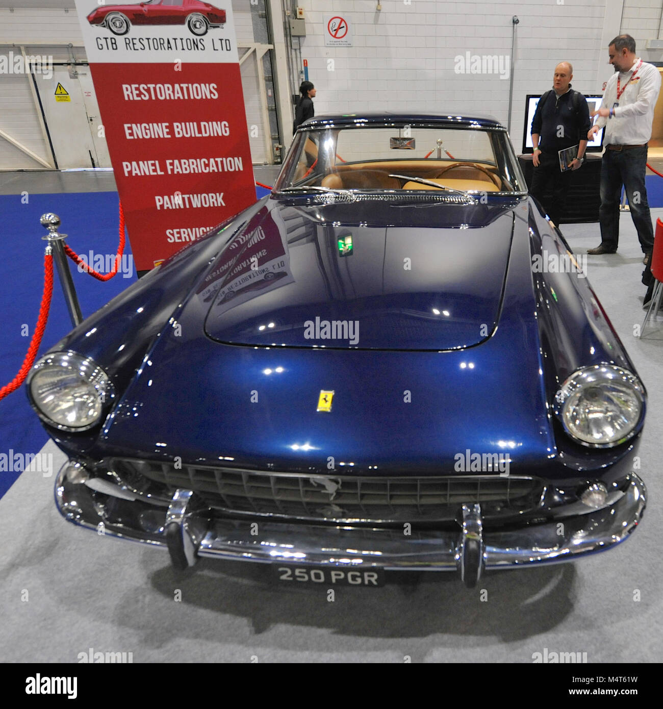 A vintage Ferrari on display at the London Classic Car Show which is ...
