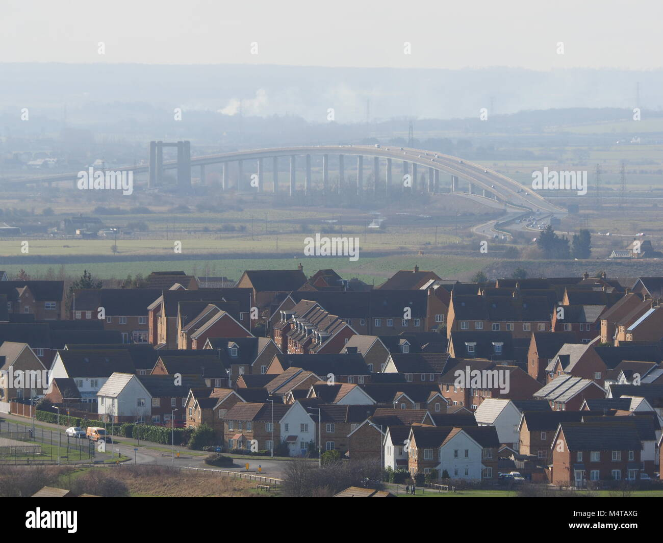 Minster on sea, Kent, UK. 18th Feb, 2018. UK Weather: another sunny and warm day in Minster on sea on the Isle of Sheppey in north Kent. The Sheppey Crossing. Temp: 10c. Credit: James Bell/Alamy Live News Stock Photo