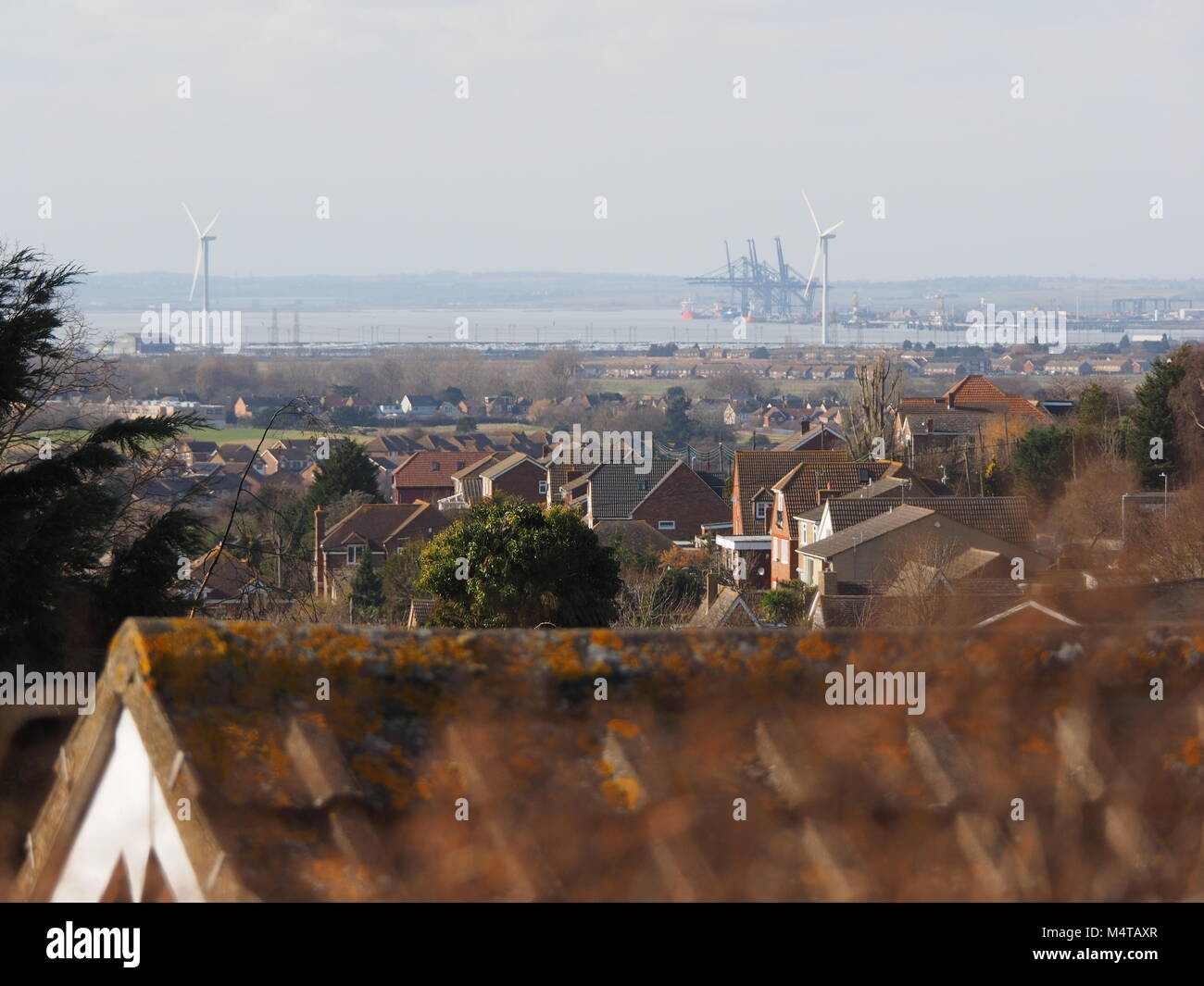 Minster on sea, Kent, UK. 18th Feb, 2018. UK Weather: another sunny and warm day in Minster on sea on the Isle of Sheppey in north Kent. Temp: 10c. View towards London Thamesport. Credit: James Bell/Alamy Live News Stock Photo