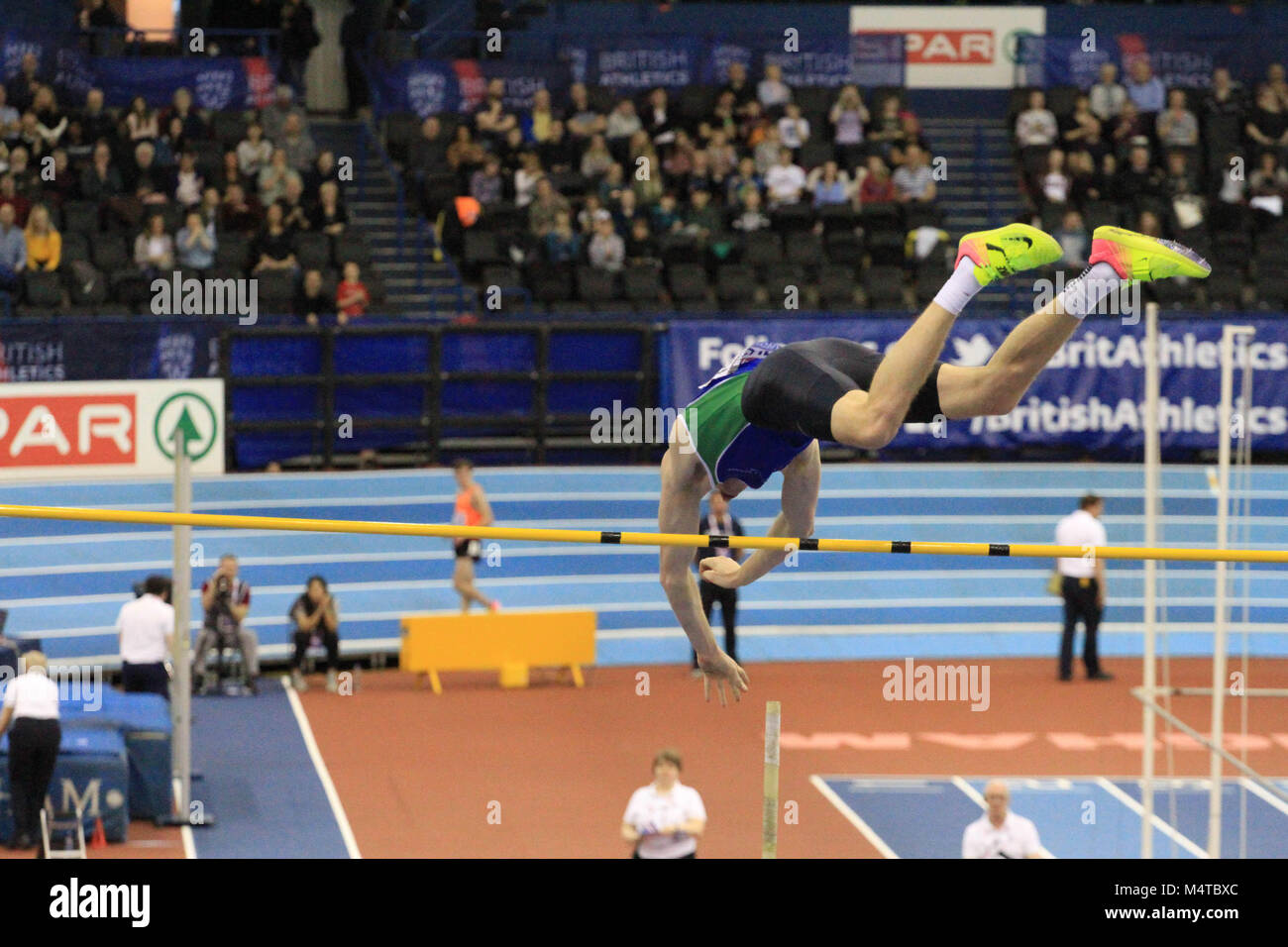 Adam Hague hits the pole during the Pole Vault at the Arena Birmingham as he competes to become British champion - Stock Image