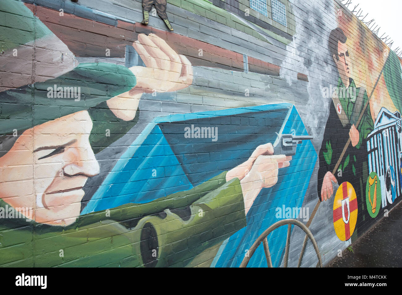 Republican mural commemorating The Troubles, Falls Road, Belfast, Country Antrim, Northern Ireland. - Stock Image