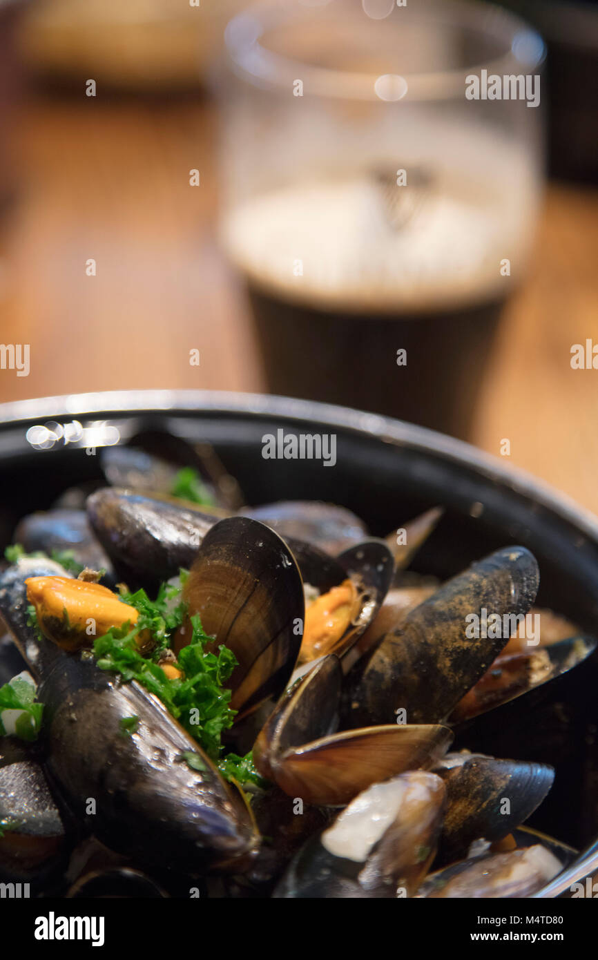 Mussels and Guinness - great Irish pub food. Clifden, County Galway, Ireland. Stock Photo