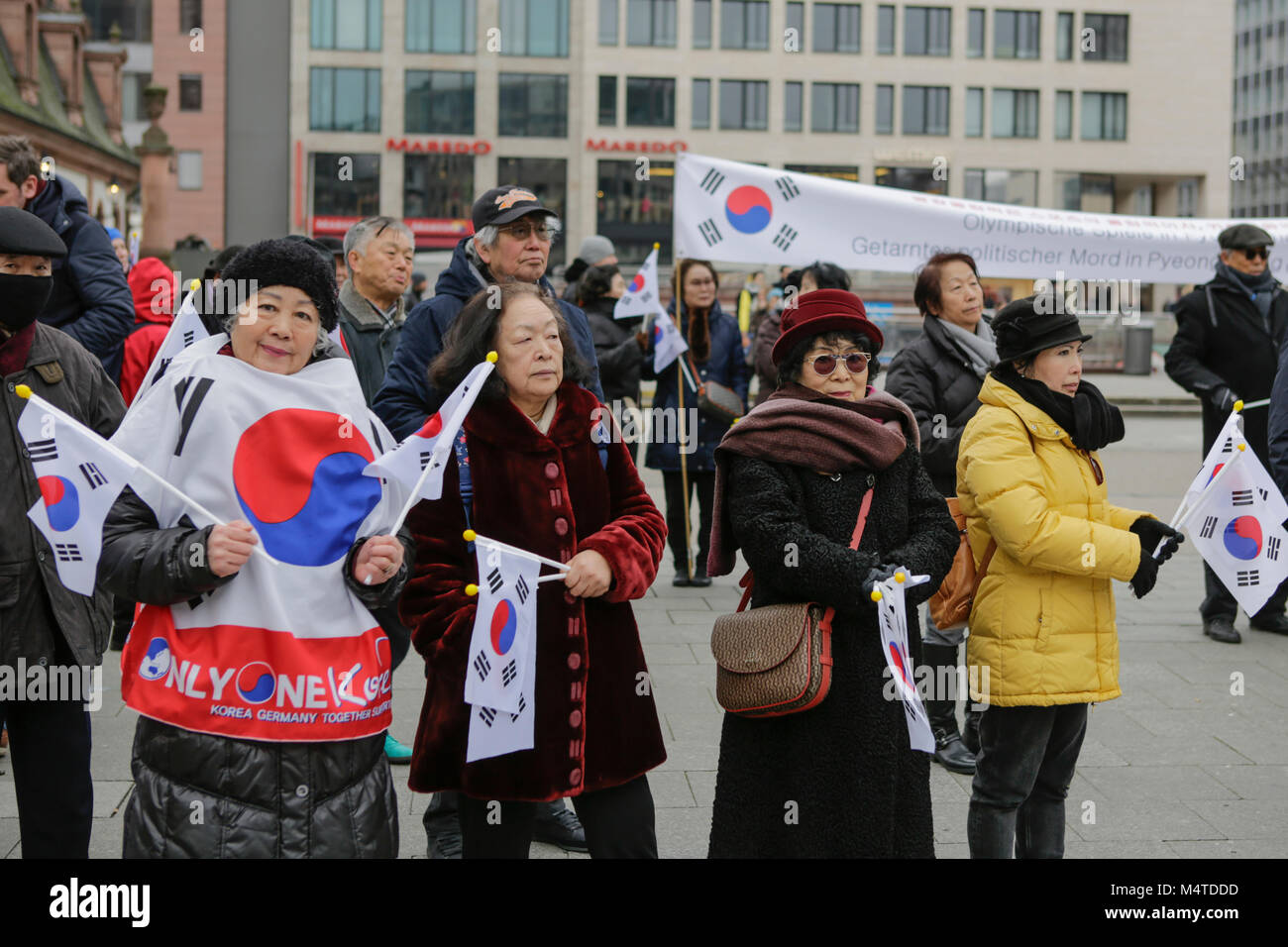 Frankfurt, Germany. 17th Feb, 2018. People are pictured at the rally, holding South Korean flags. South Koreans Stock Photo