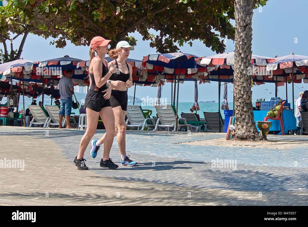 Girls running in the street as a keep fit activity - Stock Image