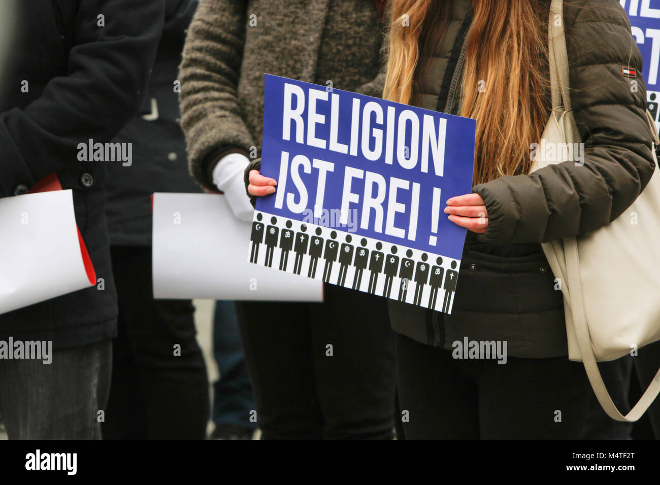 Frankfurt, Germany. 17th Feb, 2018. A sympathiser of the Human Rights Association for Forced Conversion holds up Stock Photo