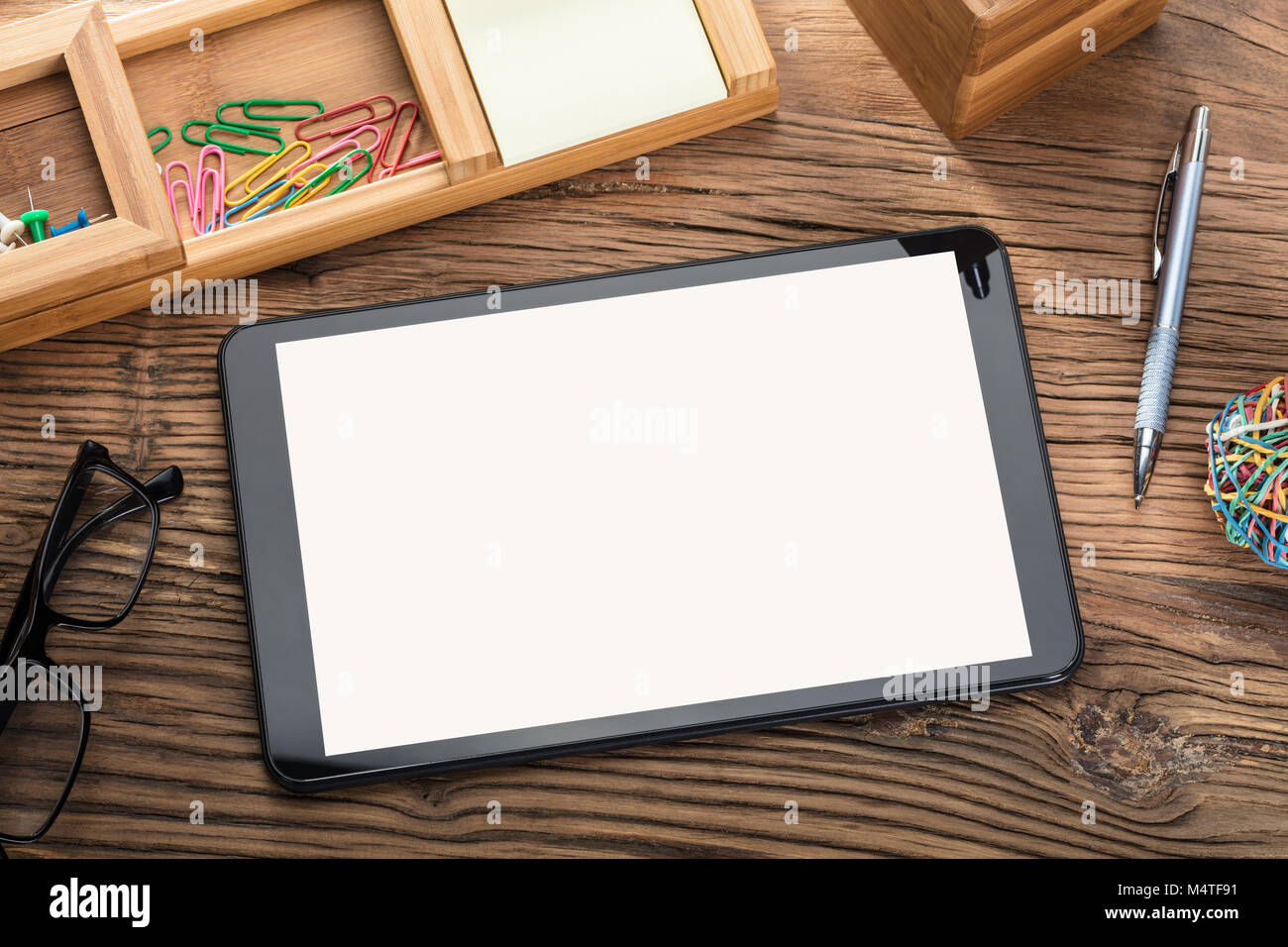 Blank Screen Digital Tablet On Wooden Table With Office Supplies - Stock Image