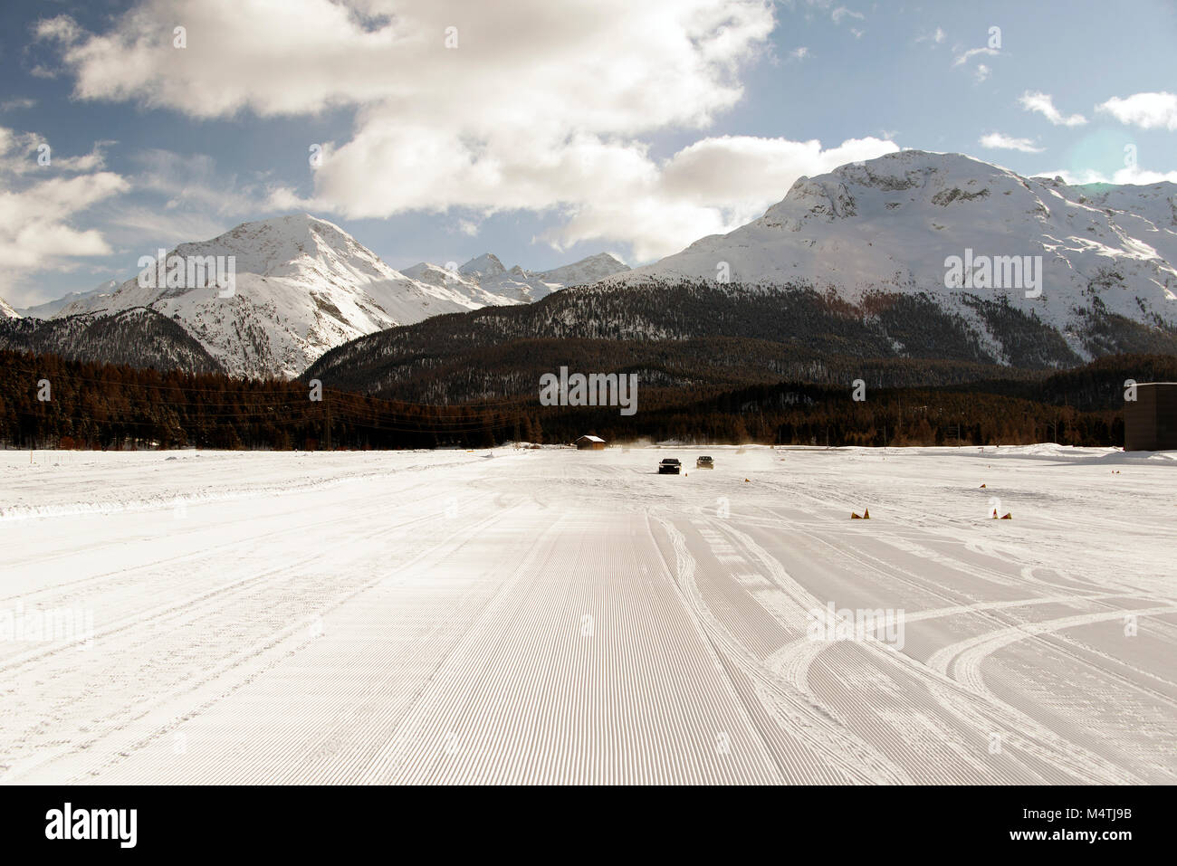 Frozen lake used as a piste in the snowy alps in st moritz alps switzerland in winter - Stock Image