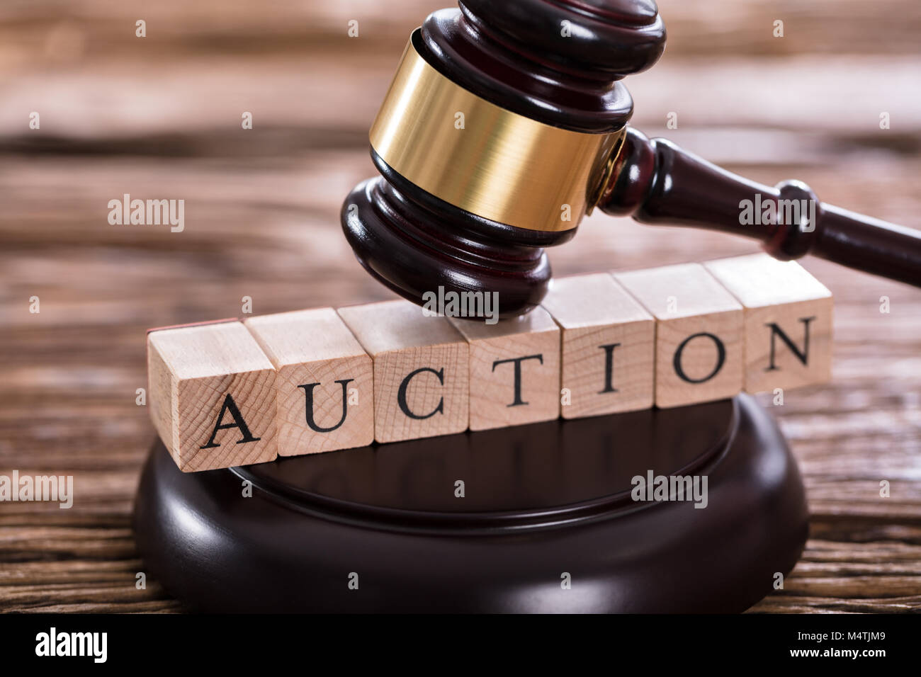 Close-up Of A Gavel Striking On Auction Word - Stock Image