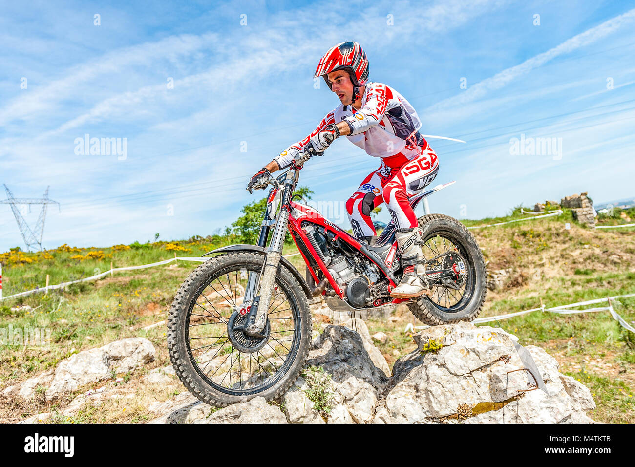 Trials motorbike rider tackles the rocks during the Portugal National Championships in Torres Vedras, Portugal. - Stock Image