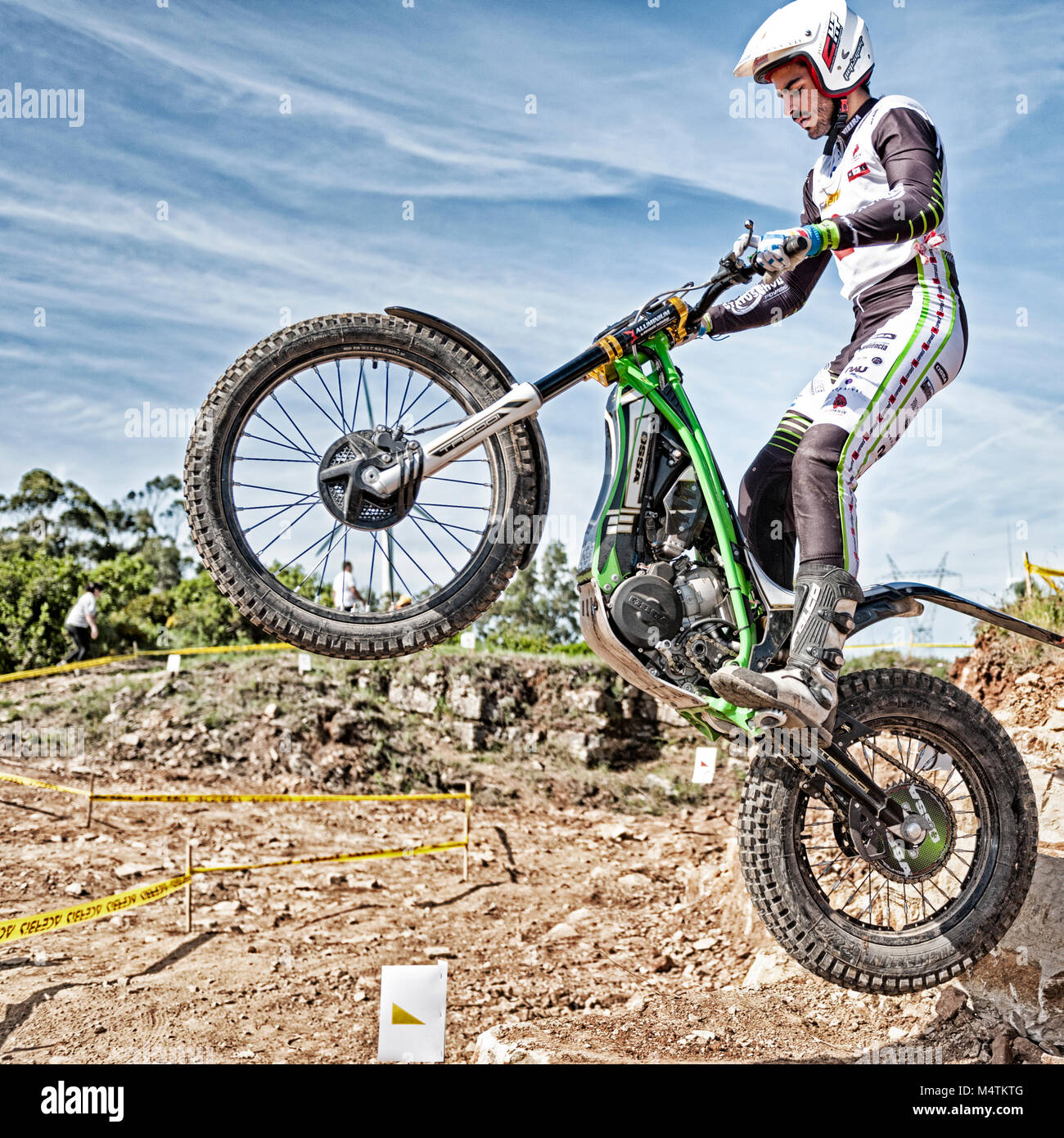 Trials motorbike rider takes to the air during the Portugal National Championships in Torres Vedras, Portugal. - Stock Image