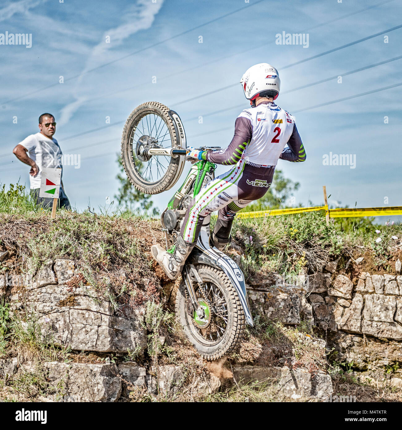 Trials motorbike rider tackles a difficult obstacle during the Portugal National Championships in Torres Vedras, - Stock Image