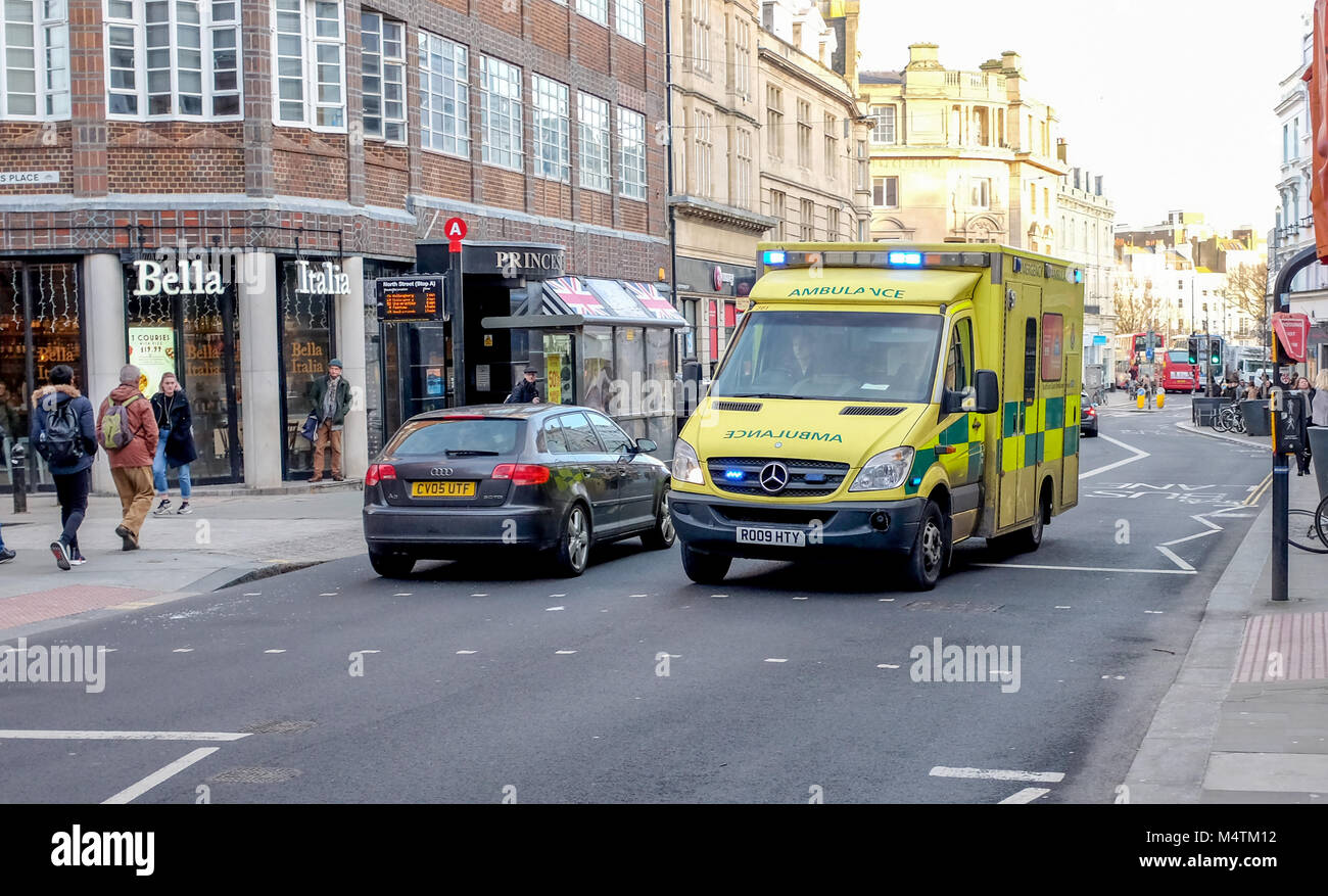 Brighton UK February 2018 - Emergency Services SECAMB ambulance driving through city with siren and blue lights - Stock Image