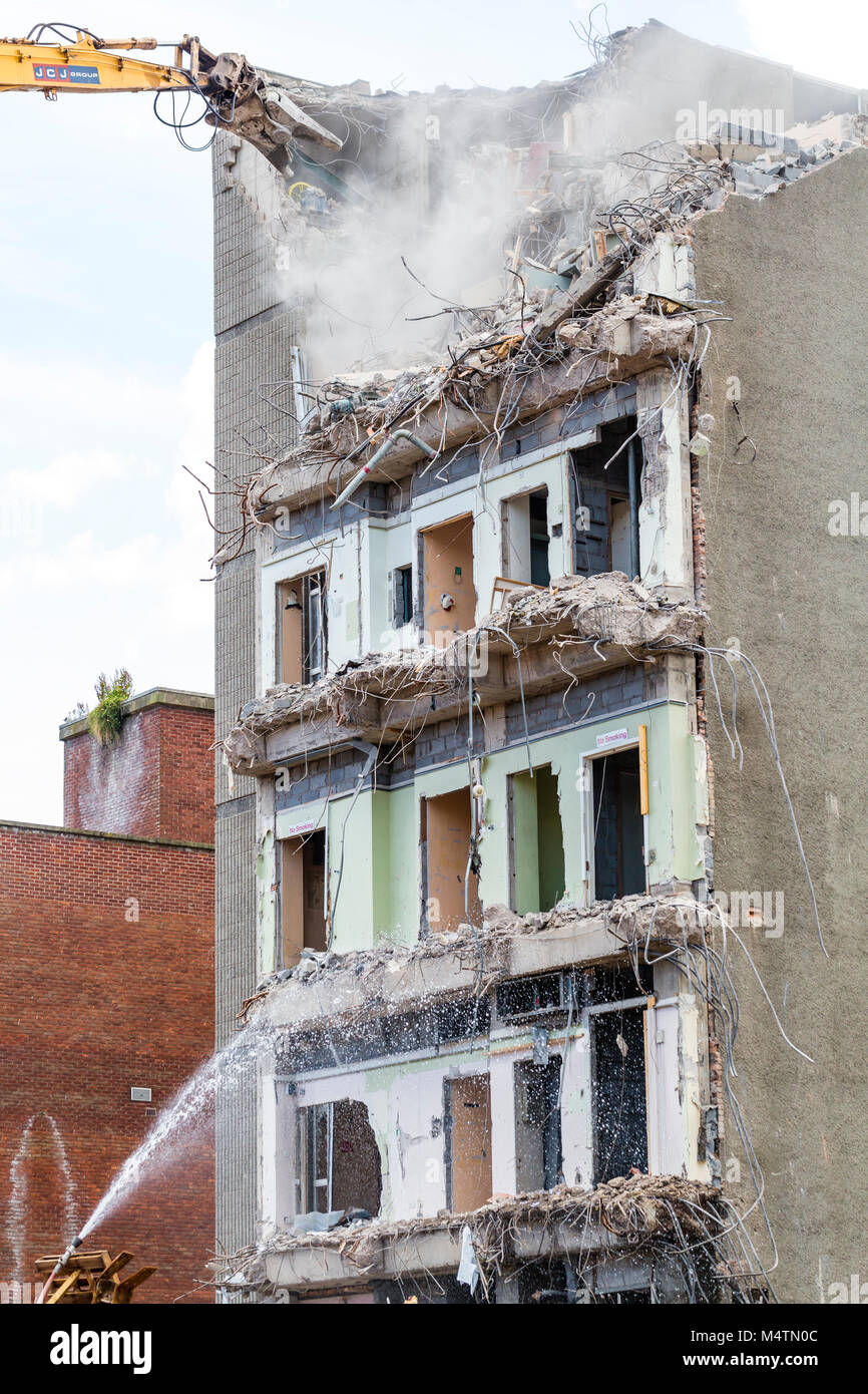 A building being demolished - Stock Image