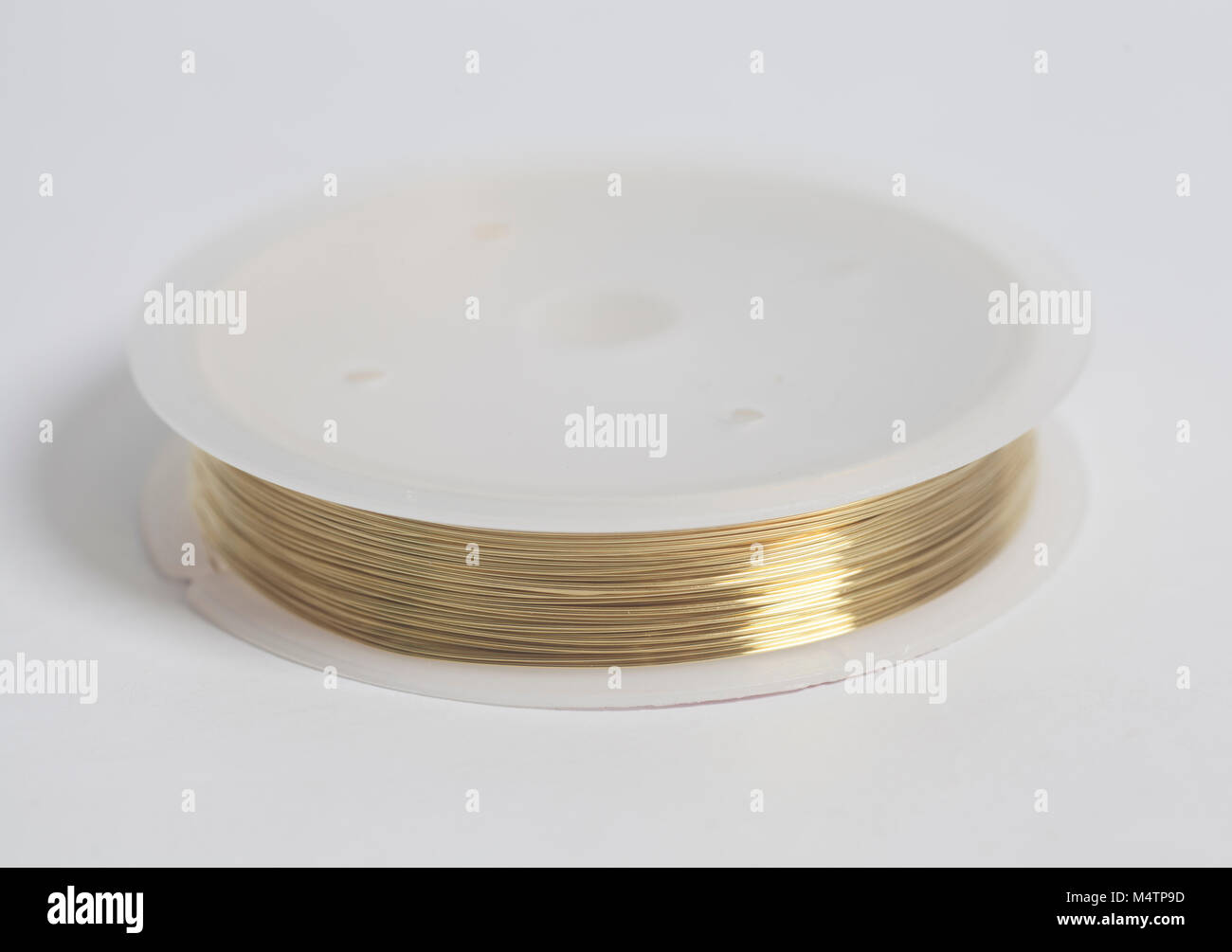 Copper wire on spool on white background Stock Photo: 175106665 - Alamy