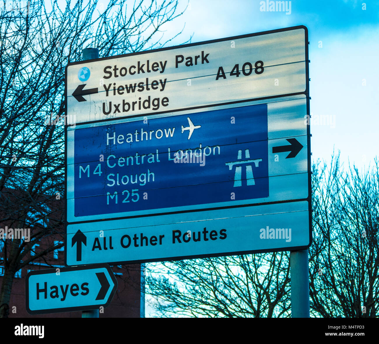 Prominent road sign in Sipson, Middlesex, Greater London, UK, pointing to various nearby suburbs and main destinations - Stock Image