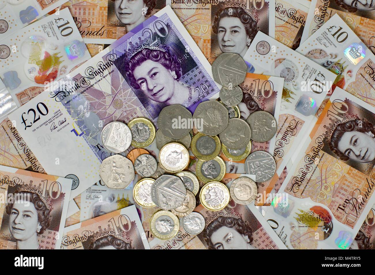 British currency, coins and notes - Stock Image