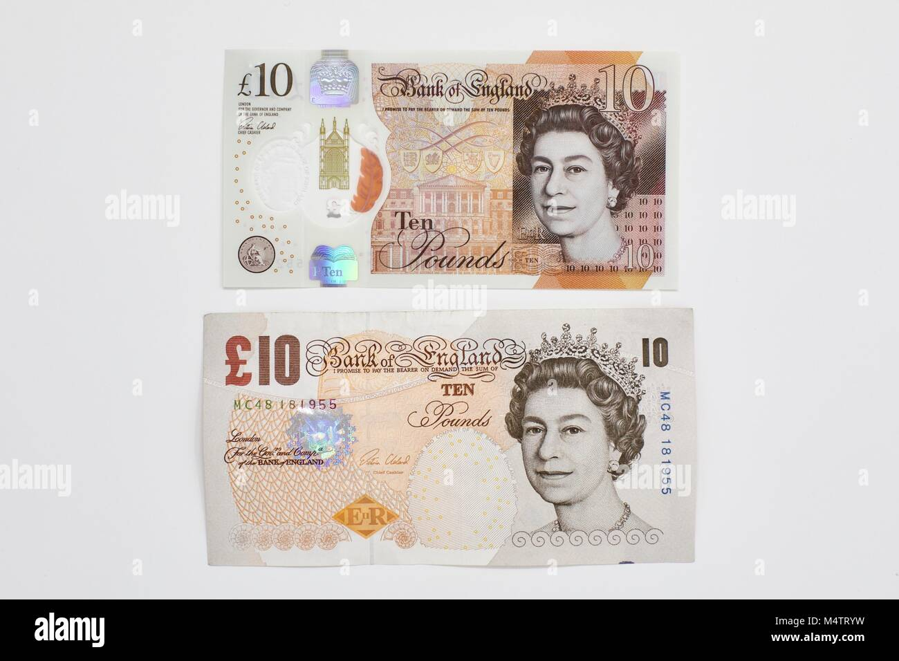 The new polymer £10 banknote and the old £10 pound banknote on a white background - Stock Image