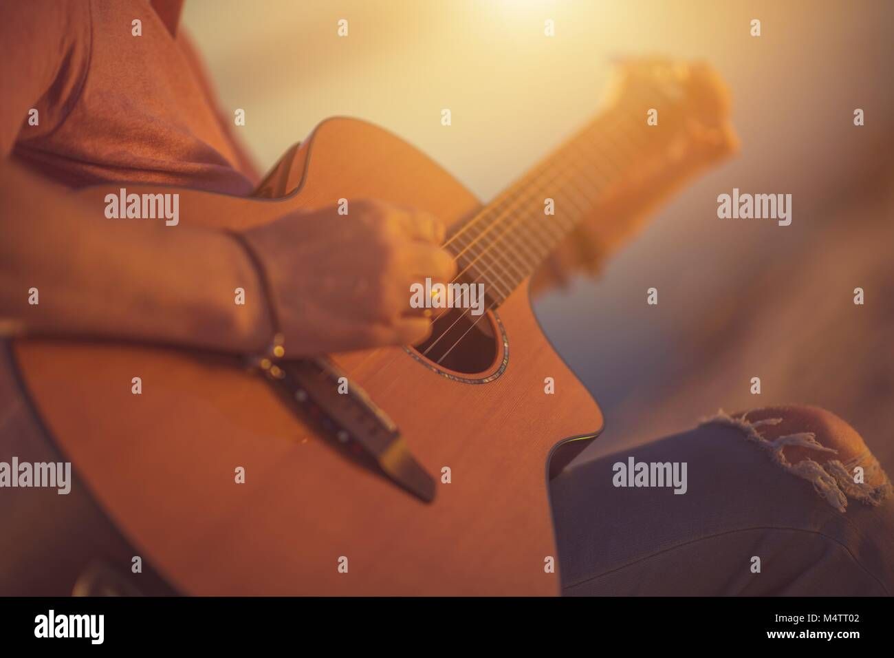 Caucasian Musician with Classic Acoustic Guitar. Guitar Ballad Playing - Stock Image