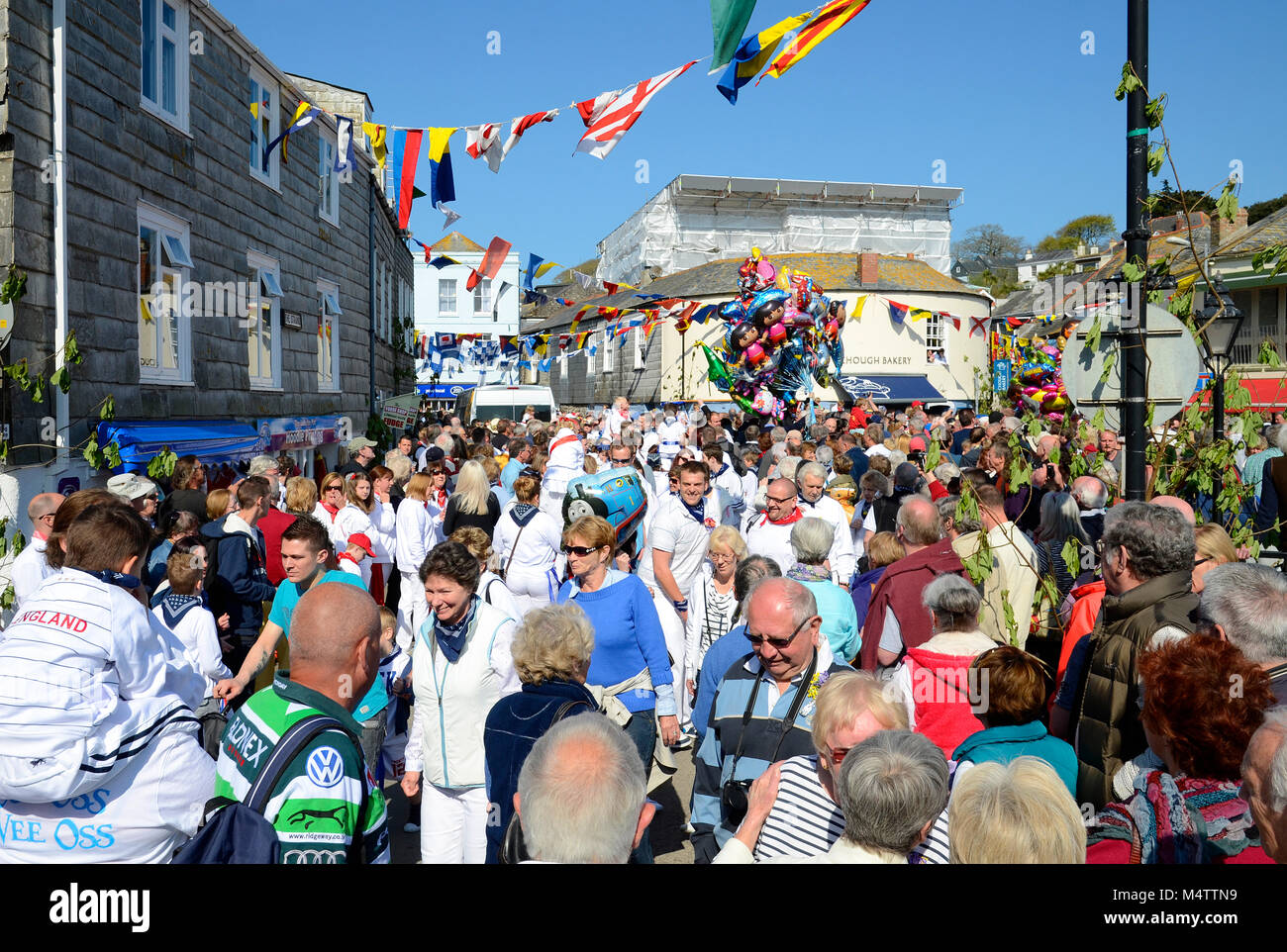 "the streets of padstow in cornwall, england, uk, are crowded with revellers during the annual may day ""obby oss"" - Stock Image"