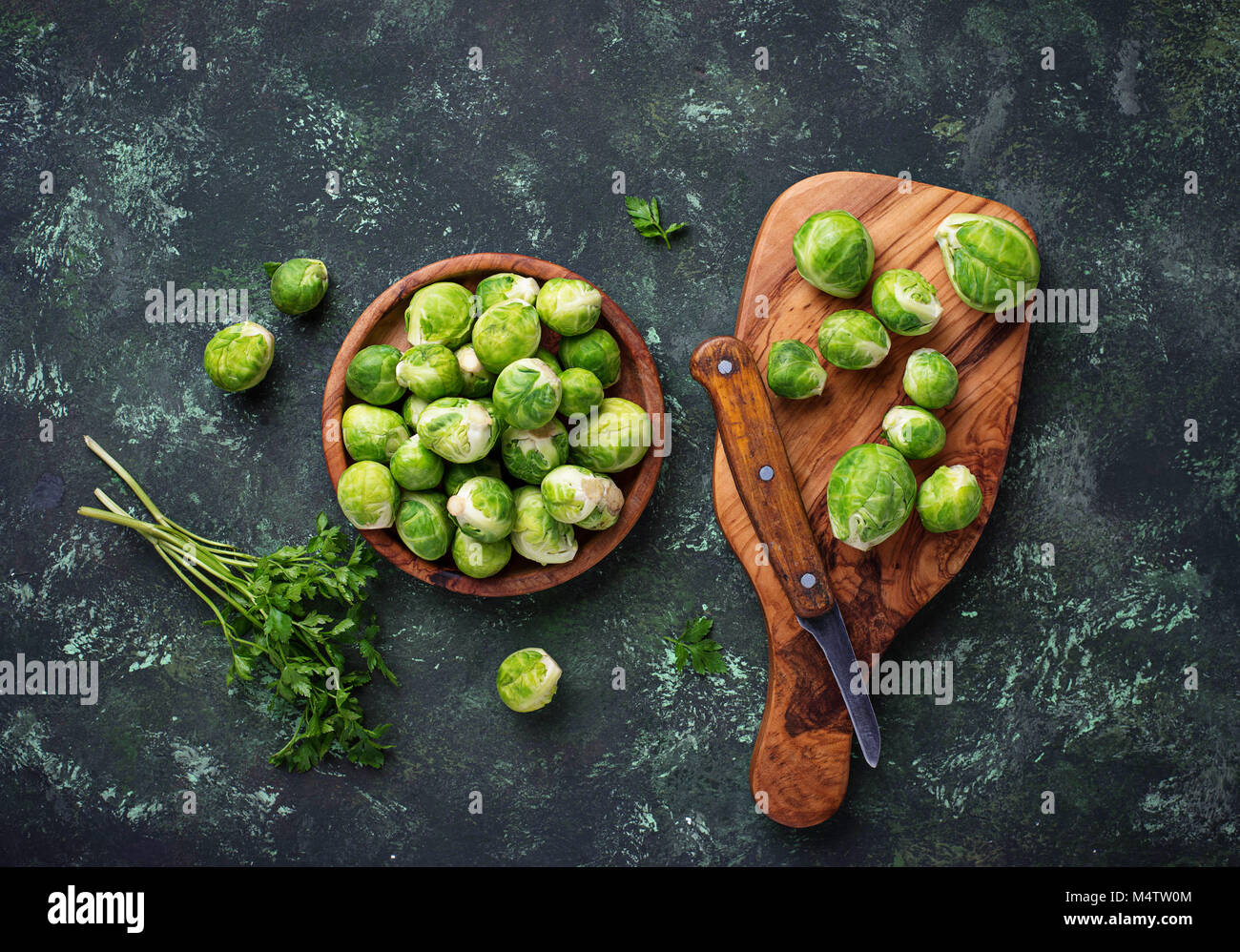 Brussels sprouts on green concrete background - Stock Image