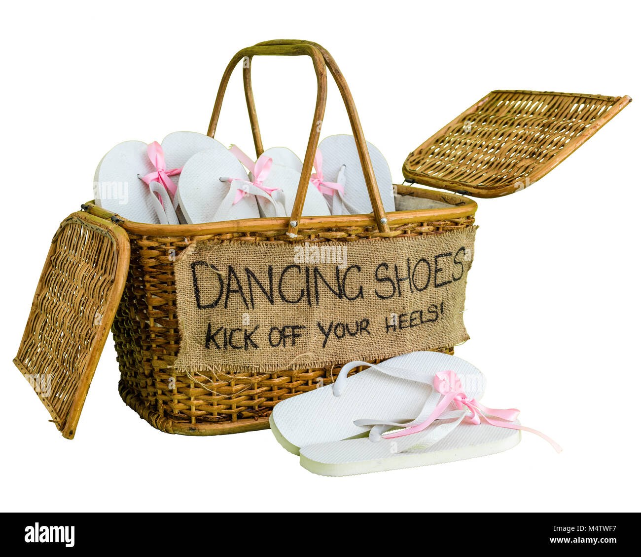 39deed29e Rattan basket with white flip-flops with pink ribbon bows for guests