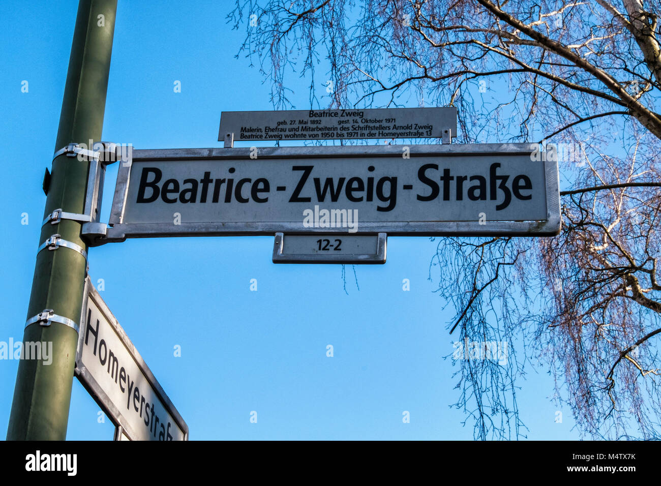 Berlin,Pankow. Beatrice Zweig Strasse street sign against blue sky - street named after 20th century artist & - Stock Image