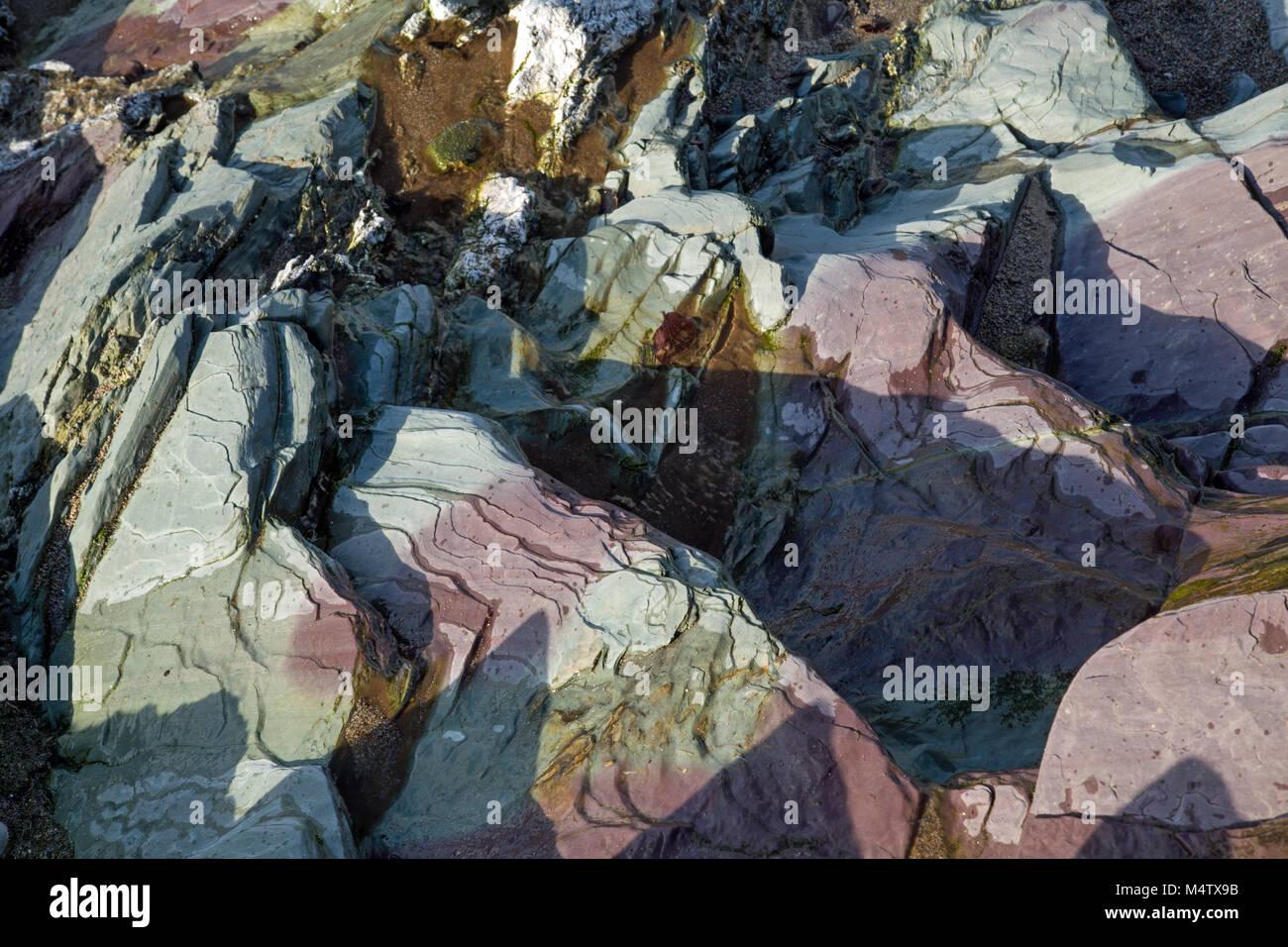 Rugged colourful rocks - Stock Image