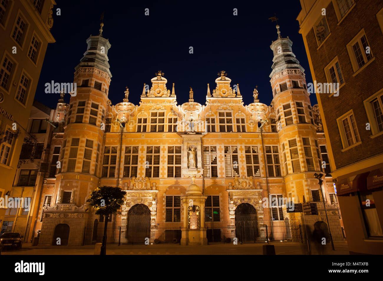 The Great Armoury - Grand Armoury (Wielka Zbrojownia) illuminated at night in city of Gdansk, Poland, Europe, Netherlandic - Stock Image