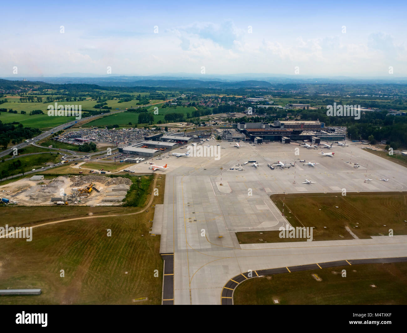 Krakow, Poland –June 27, 2017: International airport in Balice with apron, terminals, aircrafts, taxiways, construction - Stock Image