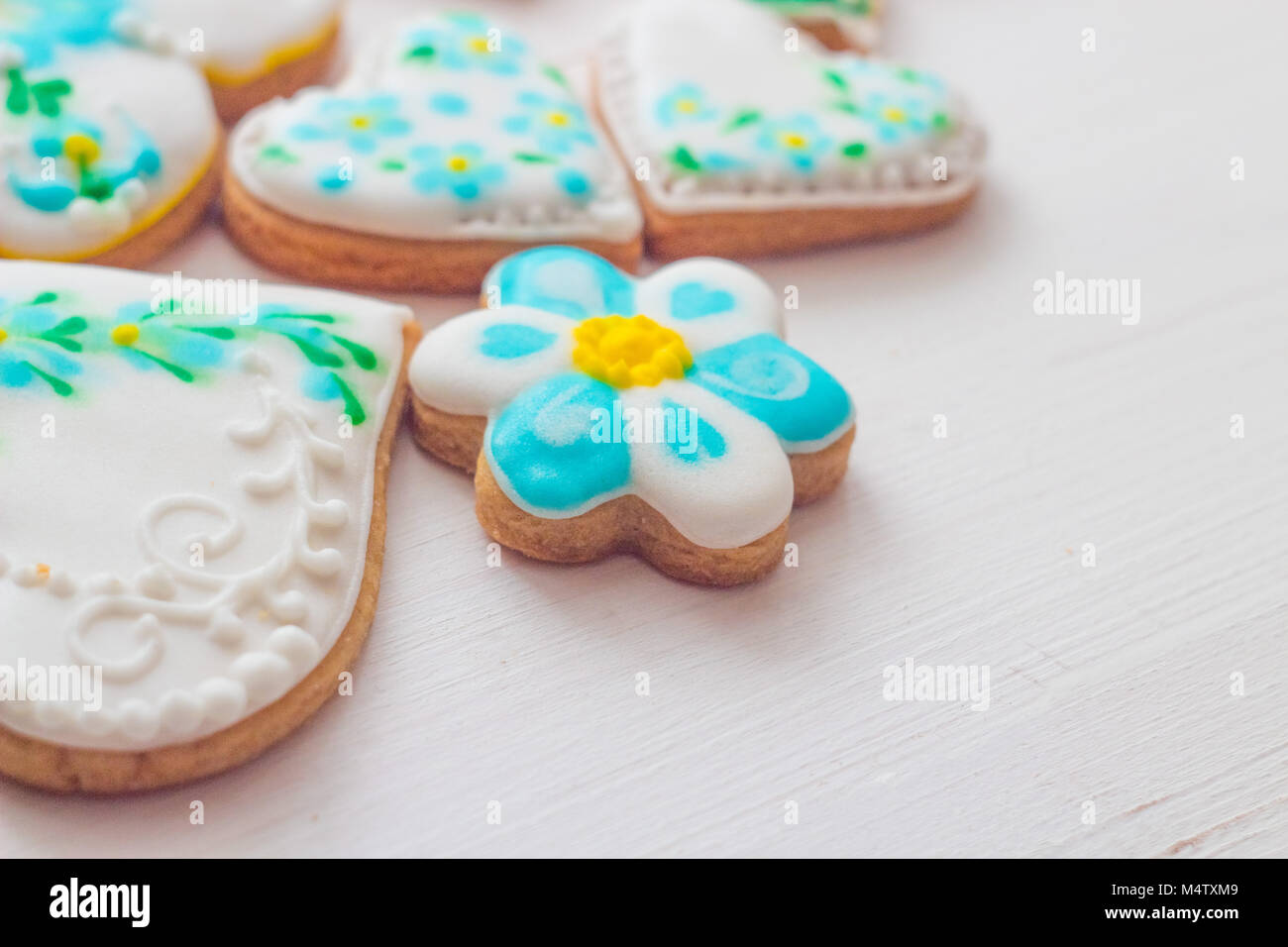 Homemade cookies made in the form of heart with multi-colored glaze. - Stock Image
