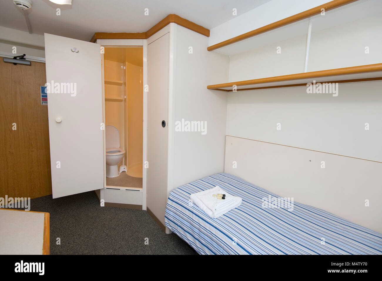 Small bedroom and study student accommodation area in university halls. - Stock Image