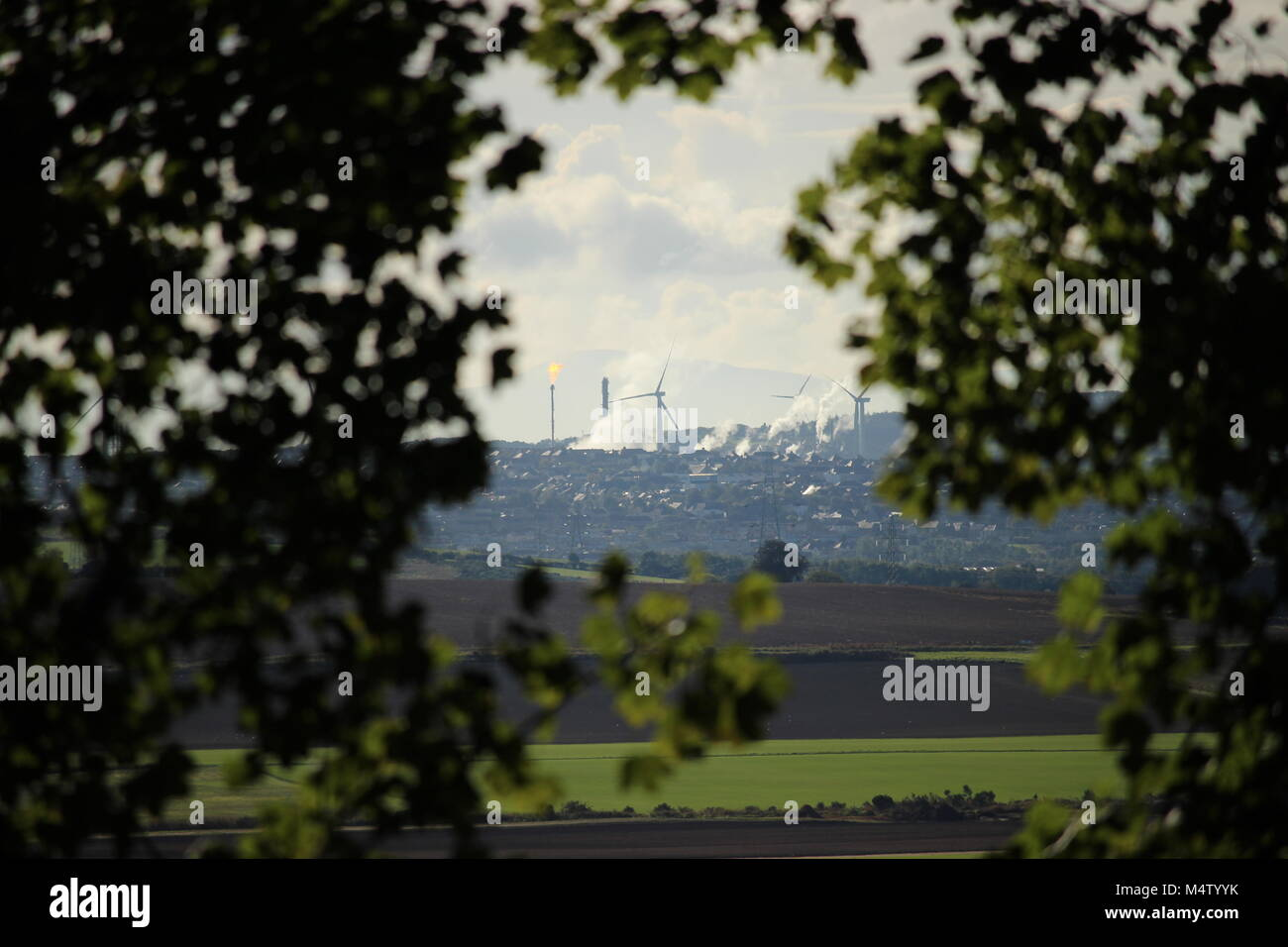 polluting Industrial site behind trees from Bishop hill - Stock Image