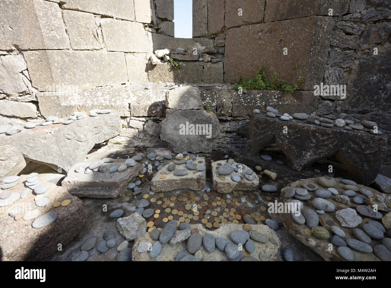 Religious offerings in The Seven Churches, Inishmore, Aran Islands, County Galway, Ireland. - Stock Image