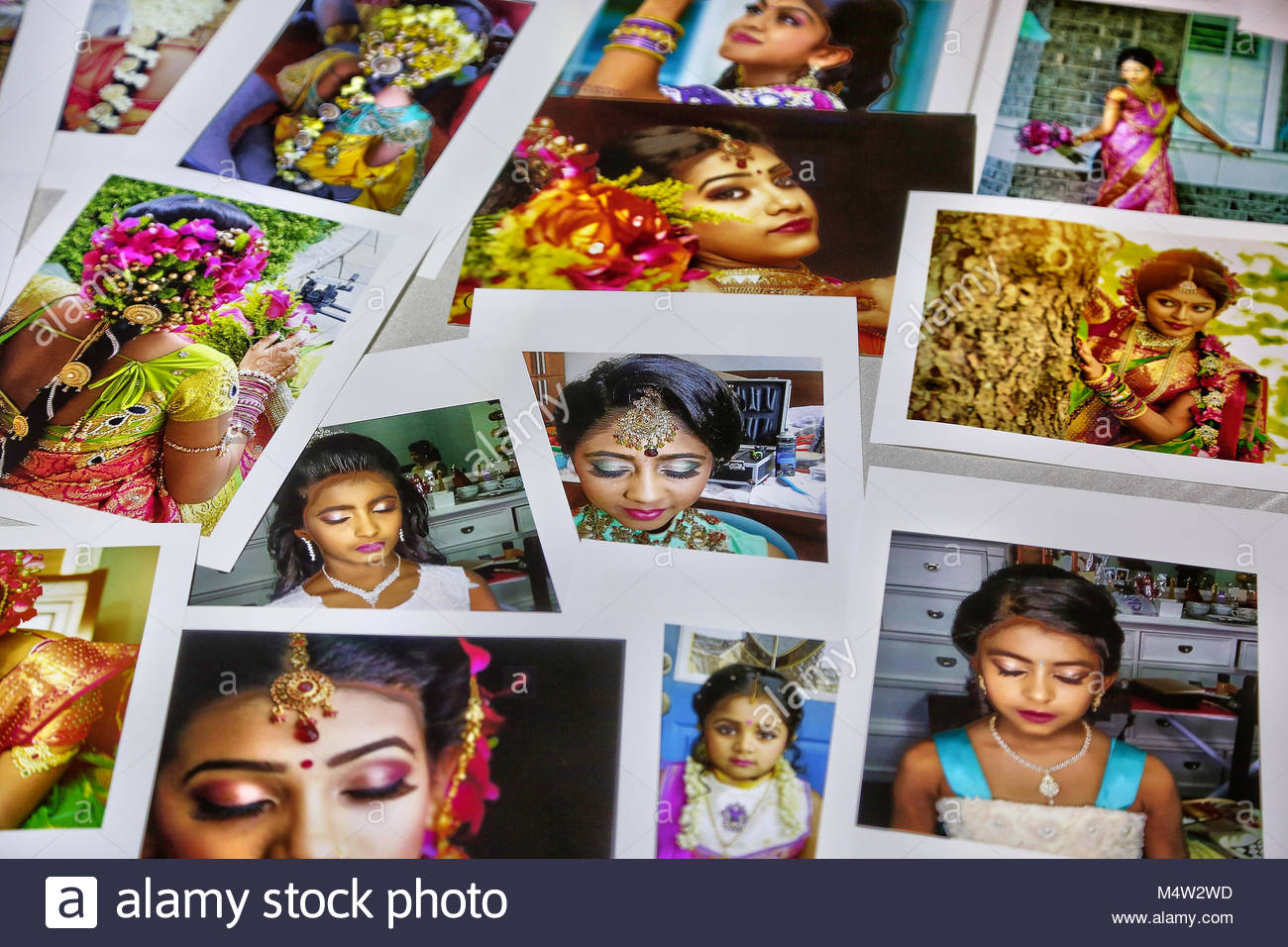 Assortment of photographs of Tamil Hindu brides and girls during their puberty ceremony displayed at a photo-booth. Stock Photo