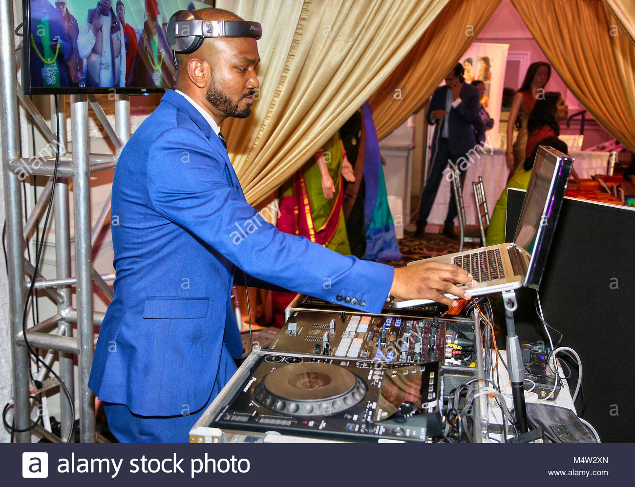 Disc jockey (DJ) entertains the crowd during an event in Scarborough, Ontario, Canada. - Stock Image