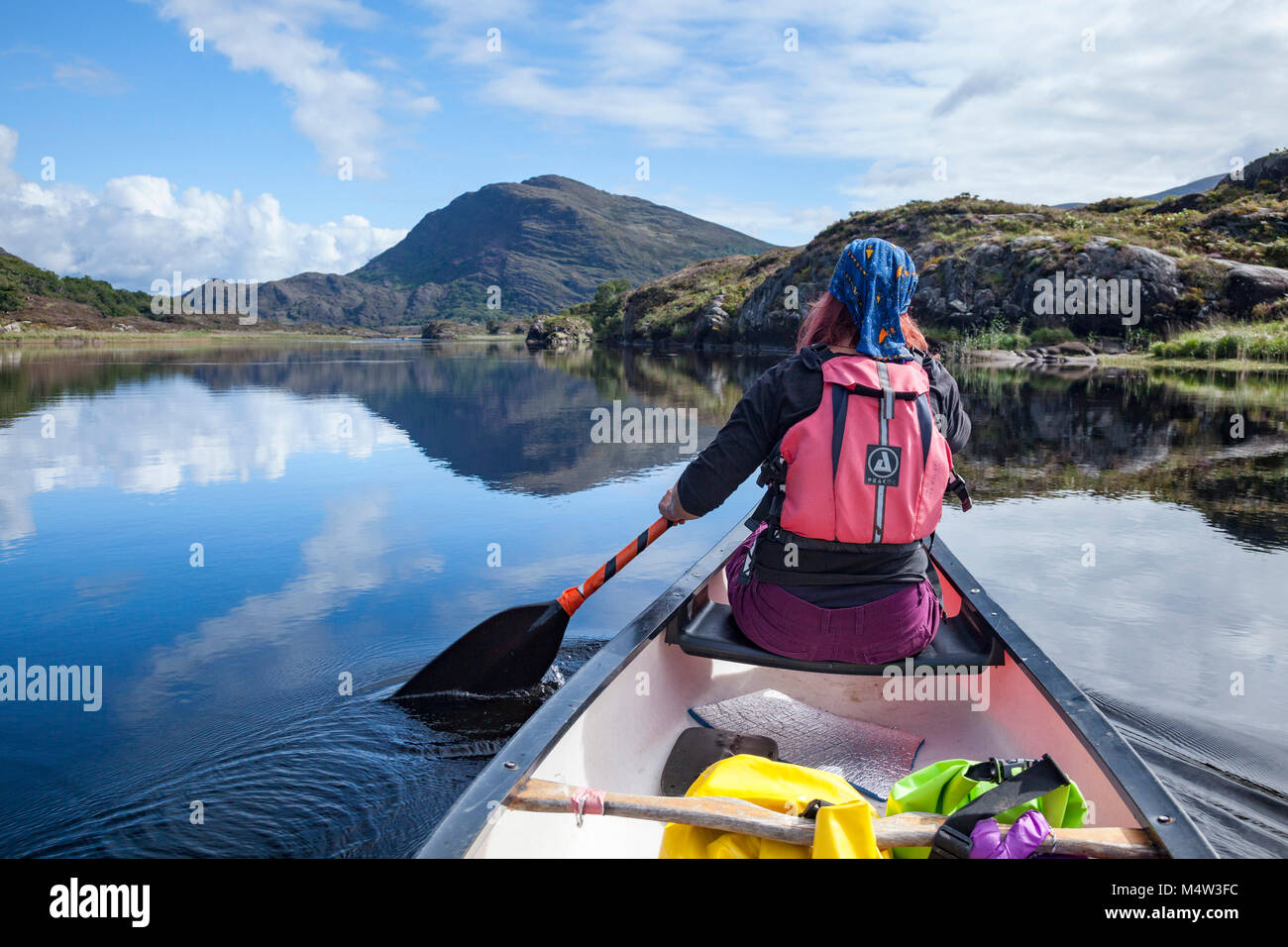 Canoeing on Upper Lough, Killarney Lakes, Killarney National Park, County Kerry, Ireland. - Stock Image