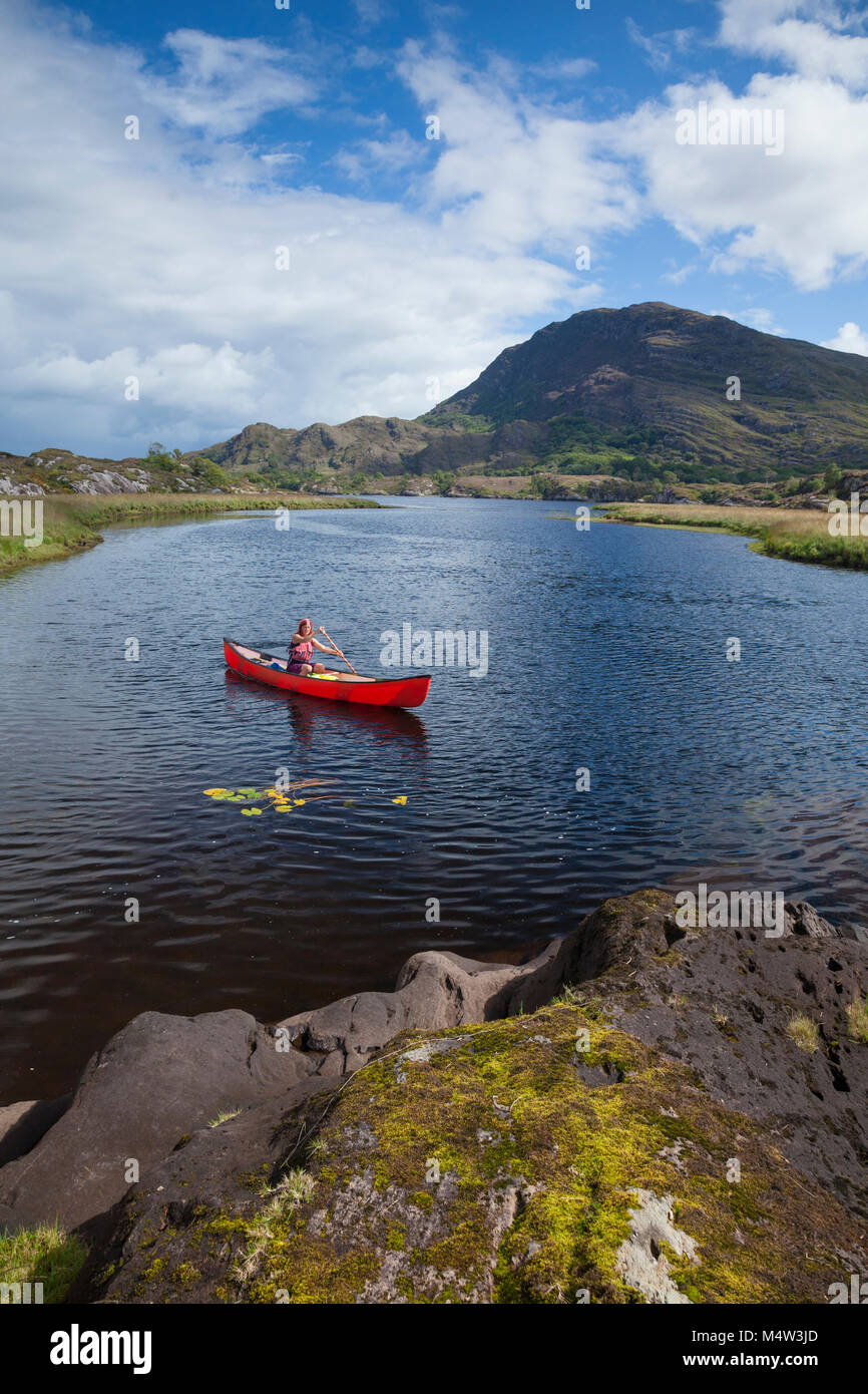 Canoeing on The Long Range, Killarney Lakes, Killarney National Park, County Kerry, Ireland. - Stock Image