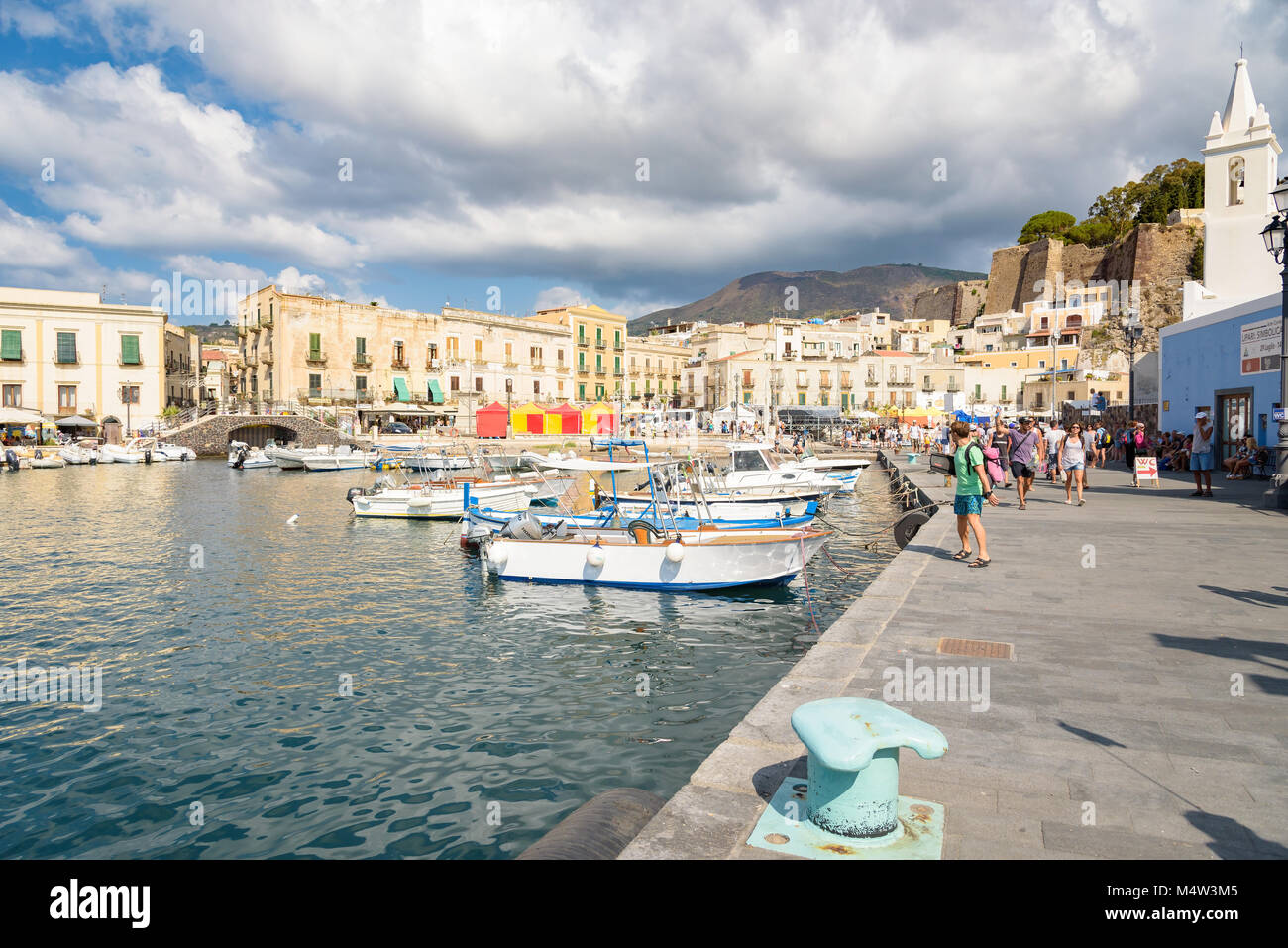 Lipari, Aeolian Islands, Italy - August 22, 2017: Tourists wait for their ship in Marina Corta on Lipari Island, Stock Photo