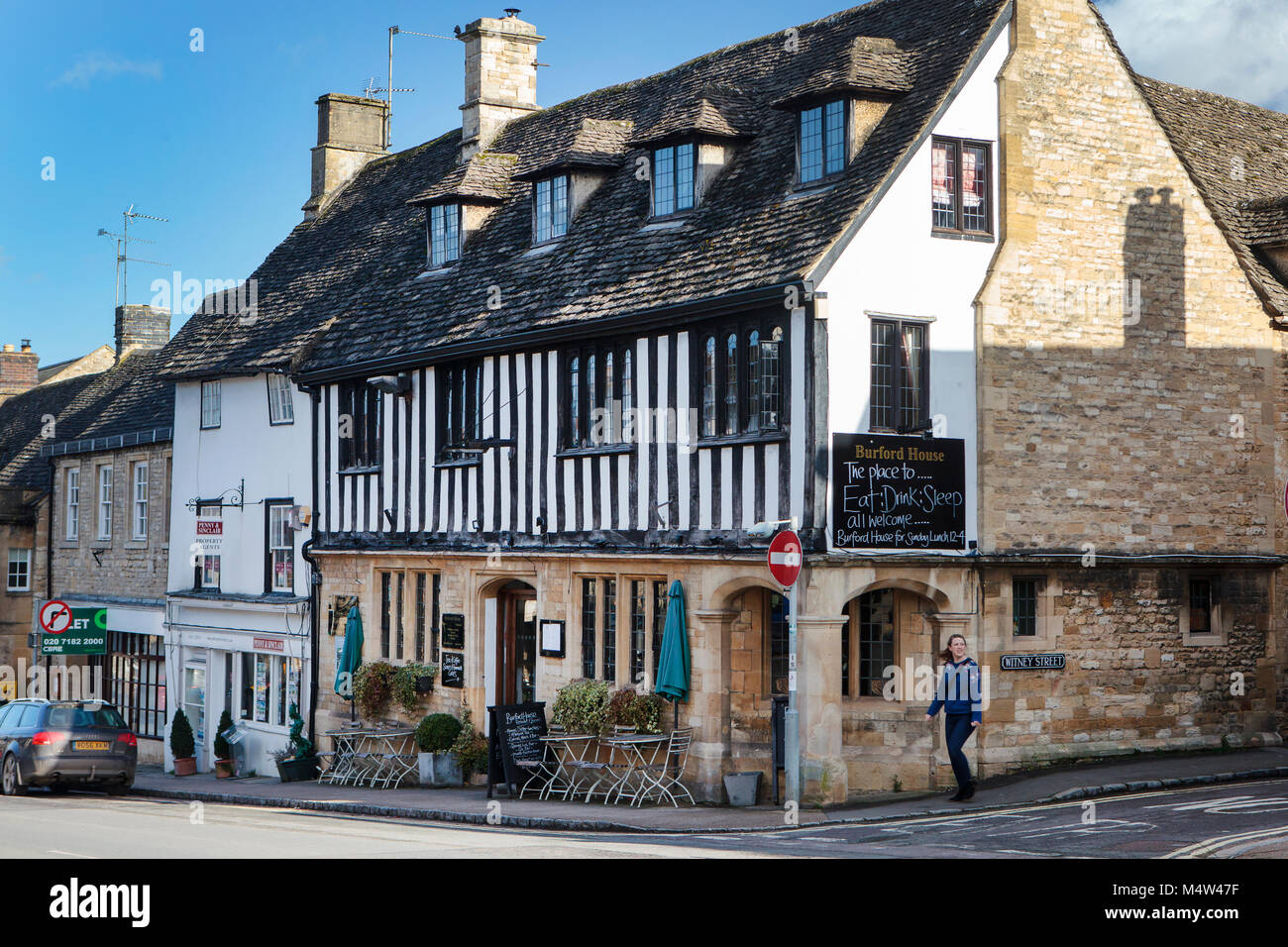 BURFORD, UK - FEBRUARY 15th, 2018: Burford is a medieval town on the River Windrush in the Cotswold hills in West - Stock Image