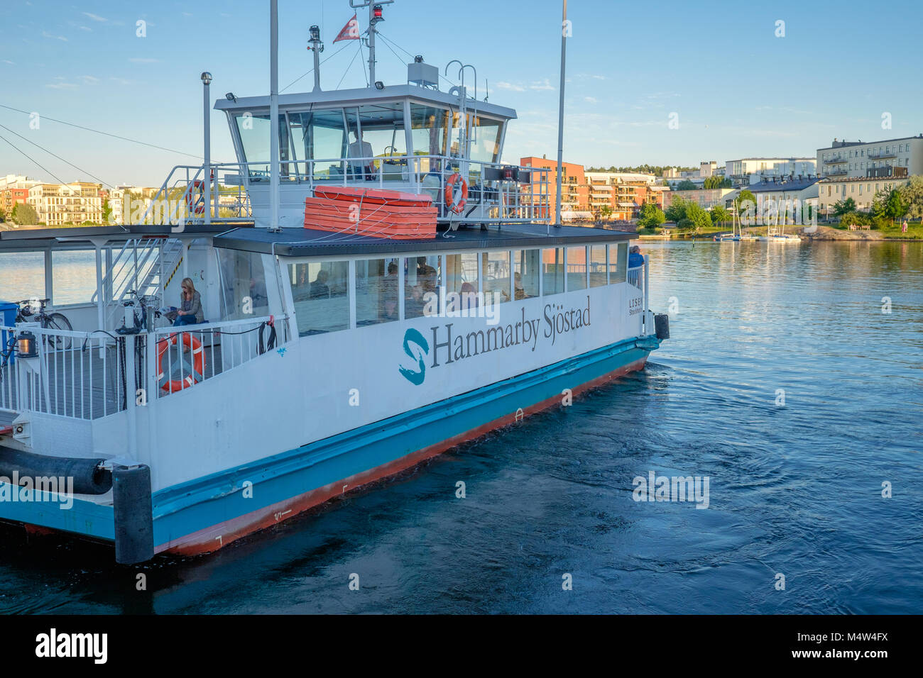 Ferry to Hammarby Sjöstad during a summer evening in Stockholm. This is a fashionable new residential area - Stock Image