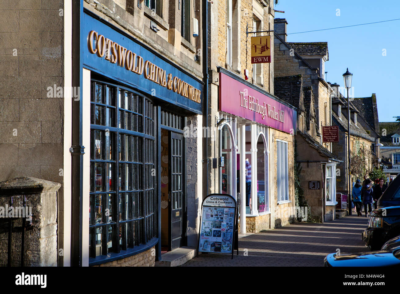BOURTON ON THE WATER, UK - FEBRUARY 15th, 2018: Row of shops in Bourton-on-the-Water, which  is a village in Gloucestershire Stock Photo