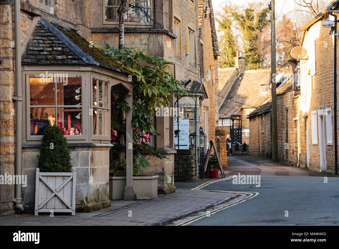 BOURTON ON THE WATER, UK - FEBRUARY 15th, 2018: Old houses and shops in Bourton-on-the-Water, which  is a village - Stock Image