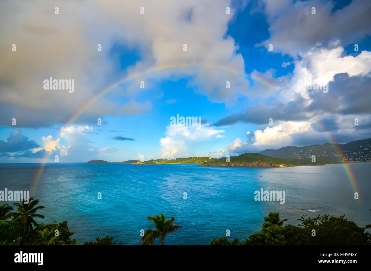 Beautiful full rainbow over Charlotte Amalie harbor in the US Virgin Islands. Stock Photo