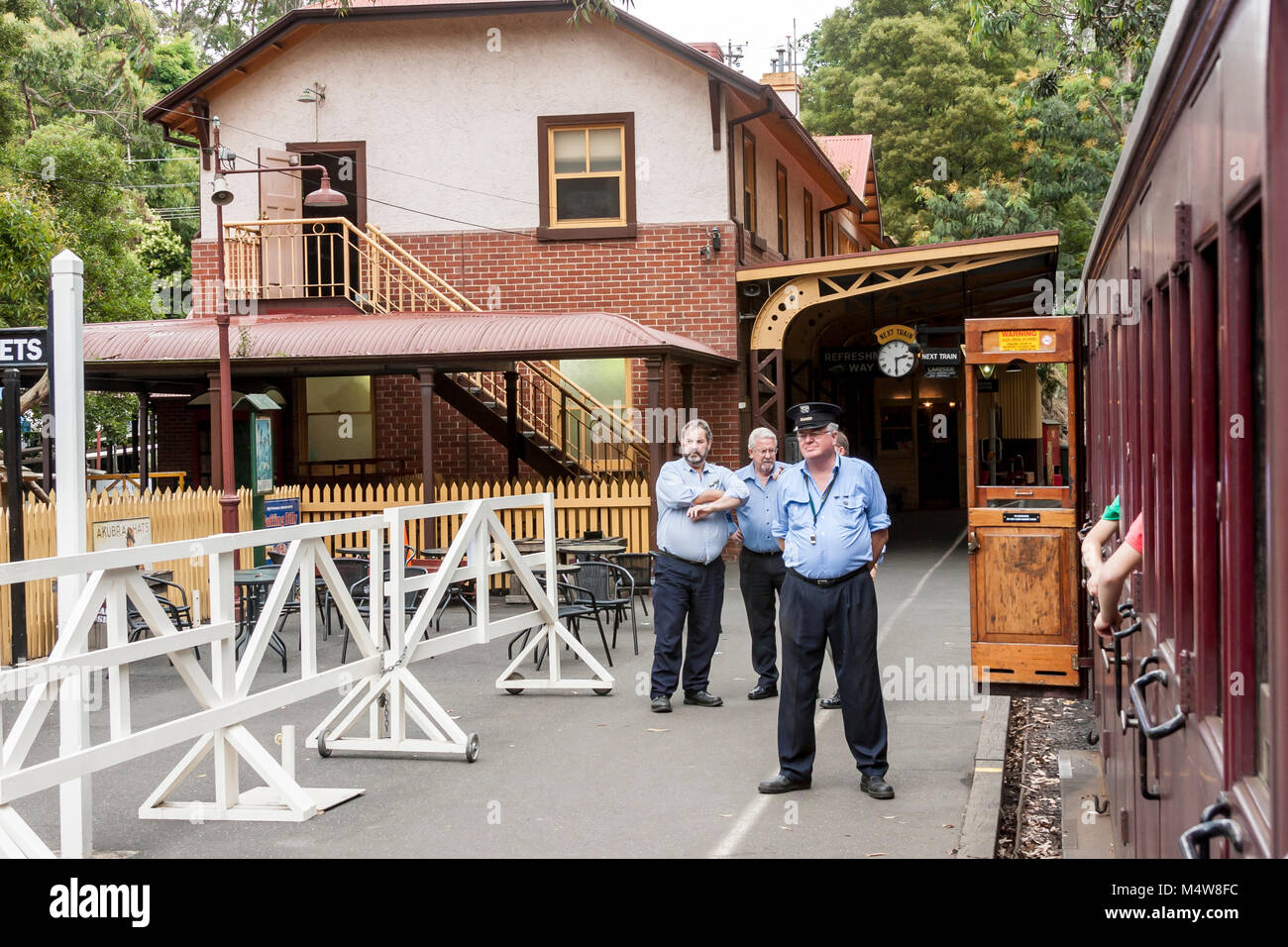 Puffing Billy is historical narrow railway in the Dandenong Ranges near Melbourne. Station master is waiting to - Stock Image