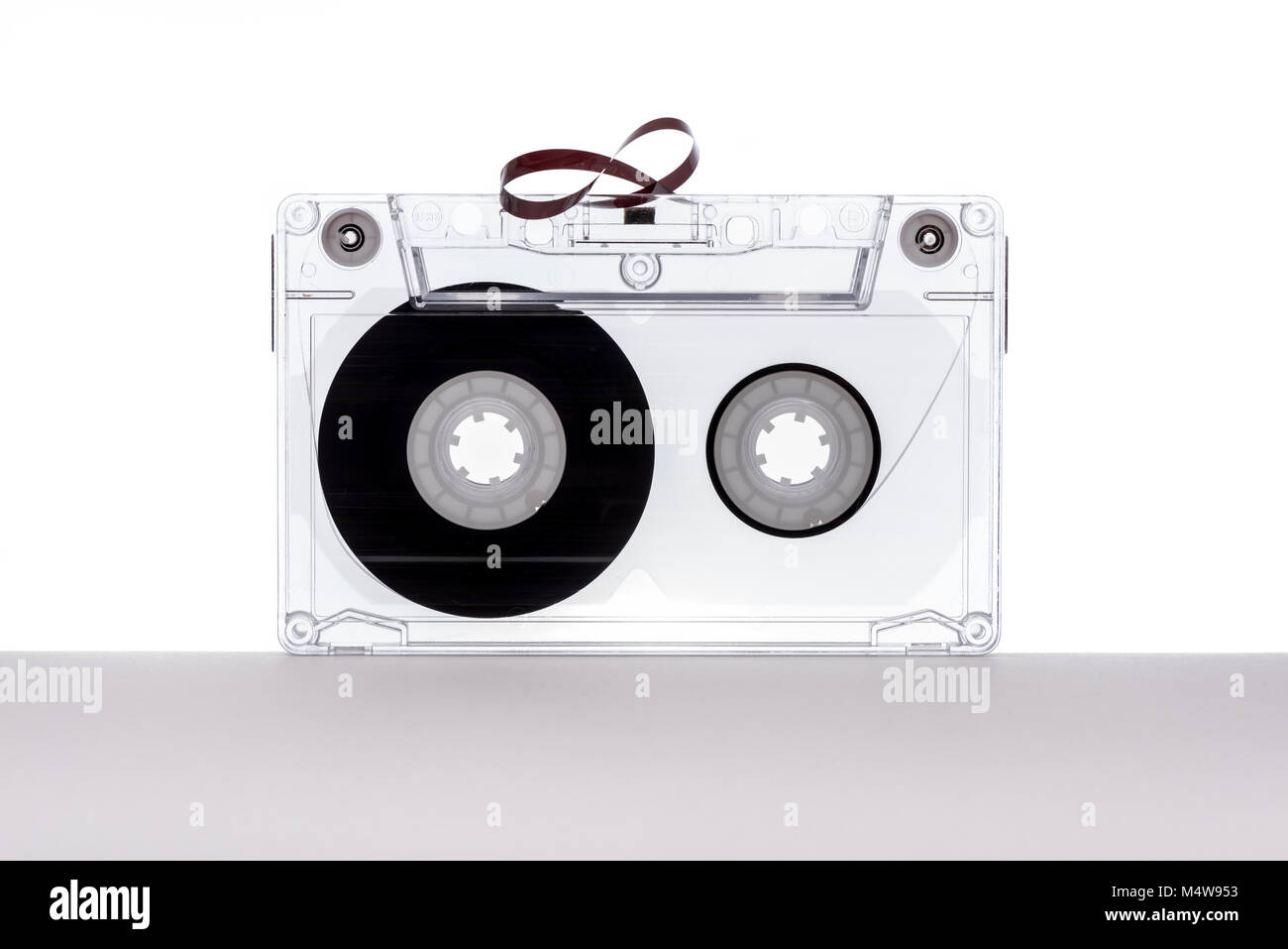 Audio tape cassette isolated on white background. Tape cassette. Magnetic tape. - Stock Image