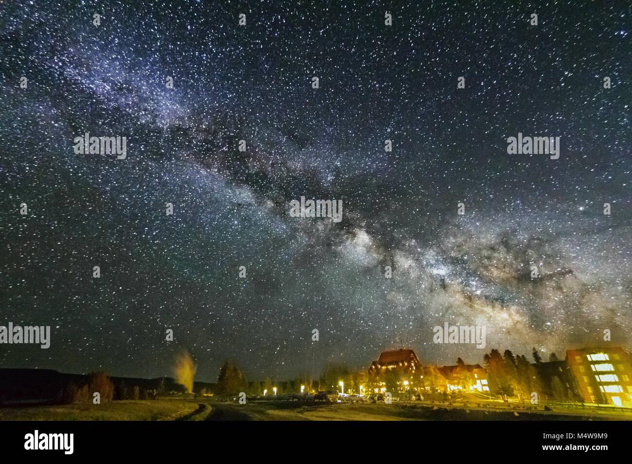 Milky Way over Old Faithful, Yellowstone National Park - Stock Image