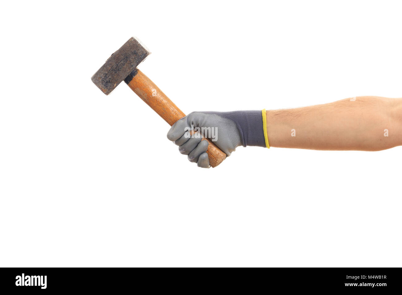 Gloved hand holding an old vintage hammer hand tool isolated on white background - Stock Image