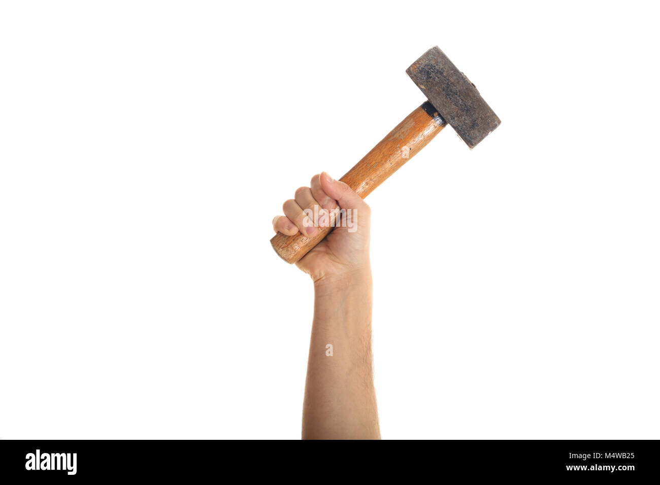 Hand holding an old vintage hammer hand tool isolated on white background - Stock Image