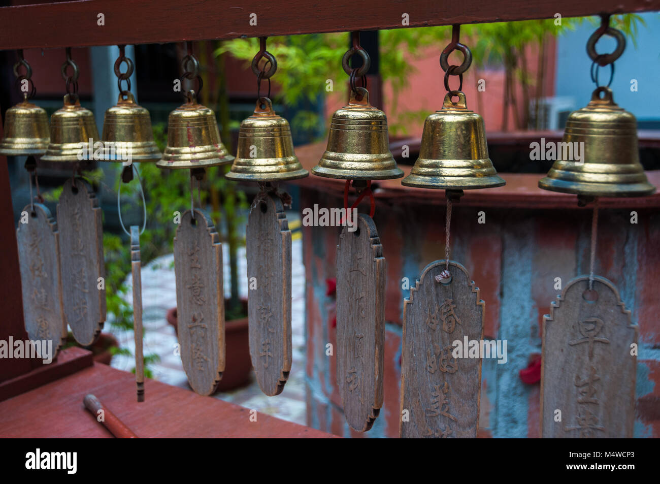 A row of bells at the  in Singapore's Chinatown area. - Stock Image
